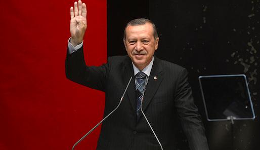 """Erdogan gesturing Rabia"" by R4BIA.com - http://www.r4bia.com/en/media-materials. Licensed under Public Domain via Wikimedia Commons"